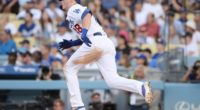 Los Angeles Dodgers infielder Gavin Lux hits a double against the Colorado Rockies