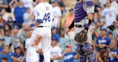 Los Angeles Dodgers infielder Gavin Lux scores a run against the Colorado Rockies