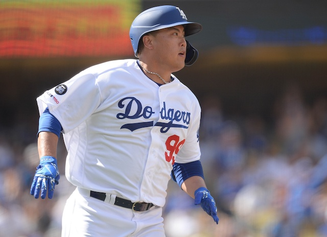 Los Angeles Dodgers starting pitcher Hyun-Jin Ryu rounds the bases after hitting a home run
