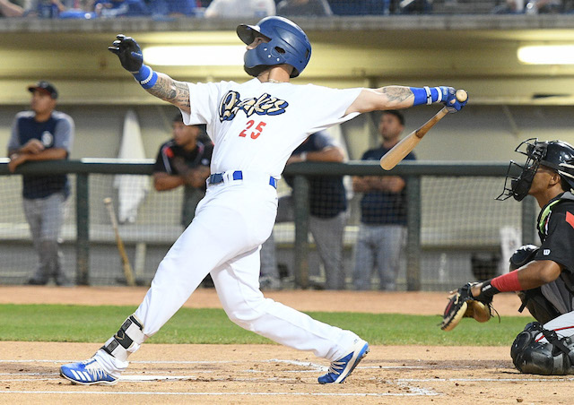 Rancho Cucamonga Quakes infielder Jacob Amaya hits a home run against the Lake Elsinore Storm in Game 3 of a 2019 California League Playoffs series