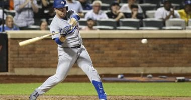 Los Angeles Dodgers infielder Jedd Gyorko hits an rBI single against the New York Mets