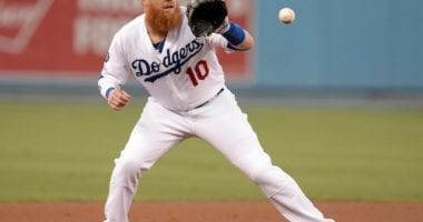 Los Angeles Dodgers third baseman Justin Turner fields a ball