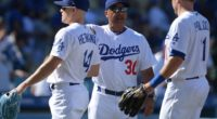 Los Angeles Dodgers manager Dave Roberts celebrates with Kiké Hernandez and A.J. Pollock after a win