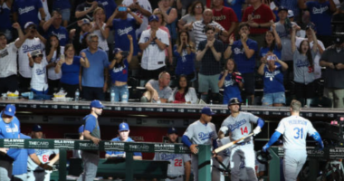 Los Angeles Dodgers manager Dave Roberts and Kiké Hernandez celebrate with Joc Pederson after a home run