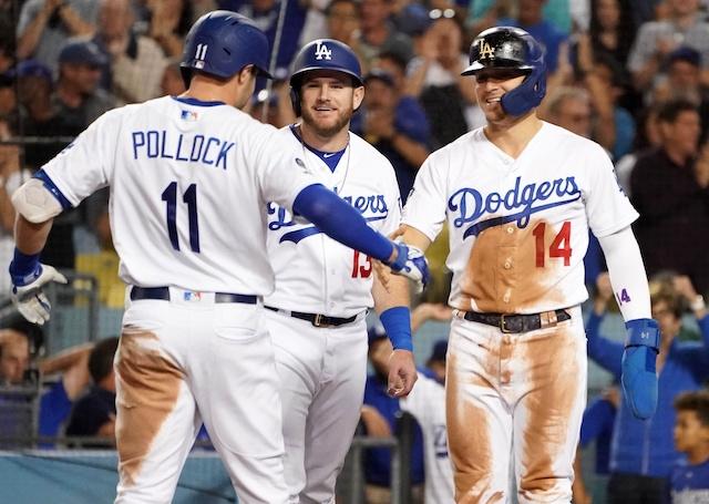 Los Angeles Dodgers teammates Kiké Hernandez, Max Muncy and A.J. Pollock celebrate after a home run