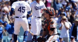 Los Angeles Dodgers teammates Matt Beaty and Cody Bellinger celebrate after a home run