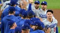 Los Angeles Dodgers teammates Matt Beaty, Joc Pederson, A.J. Pollock and Chris Taylor celebrate after a win