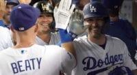 Los Angeles Dodgers teammates Matt Beaty, Kiké Hernandez and A.J. Pollock celebrate in the dugout