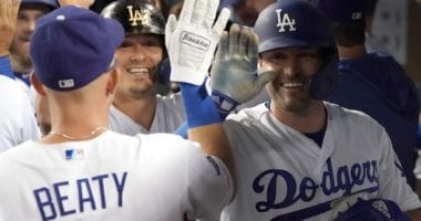 Los Angeles Dodgers teammates Matt Beaty, Kiké Hernandez and A.J. Pollock celebrate in the dugout
