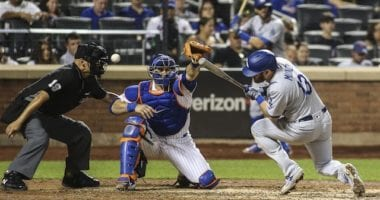 Los Angeles Dodgers infielder Max Muncy avoids being hit by a pitch