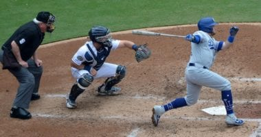 Los Angeles Dodgers infielder Max Muncy hits an RBI single against the San Diego Padres