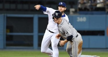 Los Angeles Dodgers infielder Max Muncy throws to first base