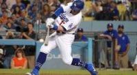 Los Angeles Dodgers infielder Max Muncy hits an RBI single against the Colorado Rockies