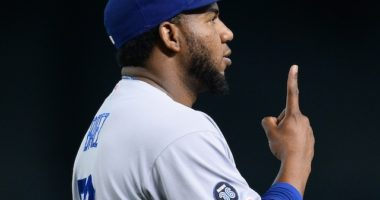 Los Angeles Dodgers relief pitcher Pedro Baez celebrates after his first career save