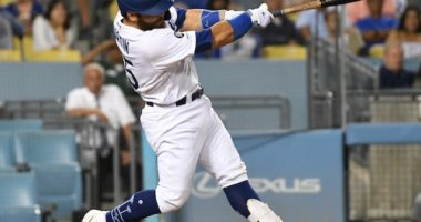 Los Angeles Dodgers catcher Russell Martin hits a home run against the Colorado Rockies