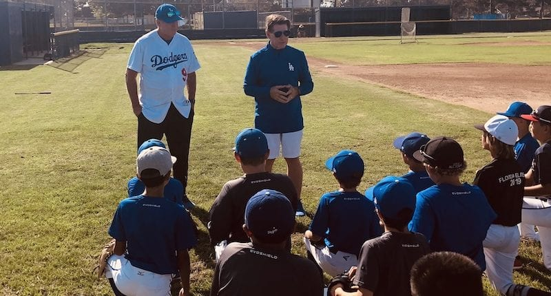 Los Angeles Dodgers legends Steve Garvey and Mickey Hatcher speak with a Lifeletics youth travel team