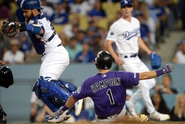 Los Angeles Dodgers catcher Russell Martin avoids a slide into home plate