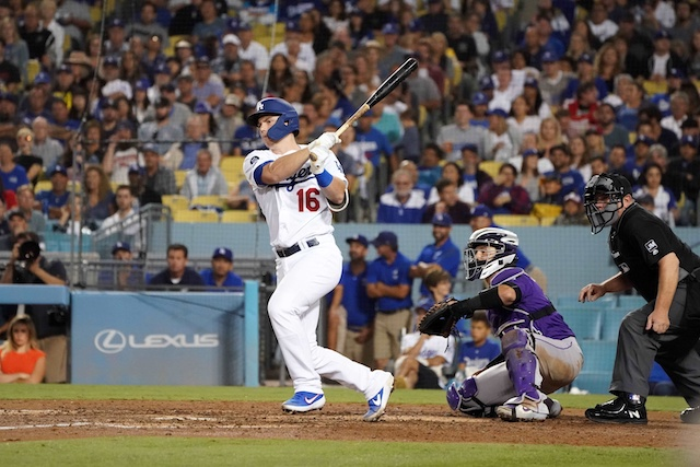 Los Angeles Dodgers catcher Will Smith hits an RBI infield single