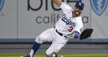 Los Angeles Dodgers utility player Chris Taylor makes a sliding catch during Game 1 of the 2019 NLDS