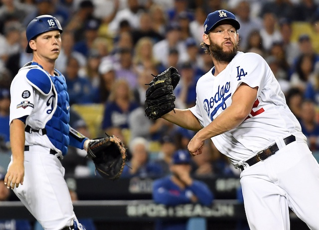 Los Angeles Dodgers starting pitcher Clayton Kershaw throws to first base during Game 2 of the 2019 NLDS