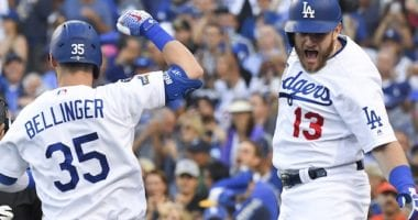Los Angeles Dodgers teammates Cody Bellinger and Max Muncy celebrate after a home run during Game 5 of the 2019 NLDS