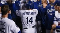 Los Angeles Dodgers teammates David Freese, Kiké Hernandez, Rich Hill and Chase Utley celebrate in the dugout