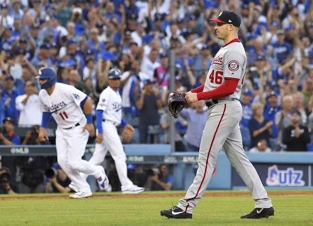 Los Angeles Dodgers outfielder A.J. Pollock scores during Game 1 of the 2019 NLDS
