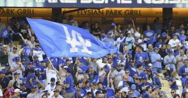 Los Angeles Dodgers fans with rally towels and a flag for the 2019 NLDS