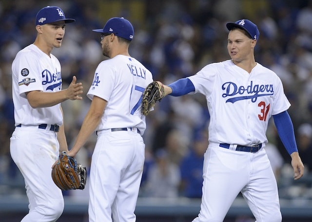 Los Angeles Dodgers teammates Joe Kelly, Joc Pederson and Corey Seager celebrate after winning Game 1 of the 2019 NLDS
