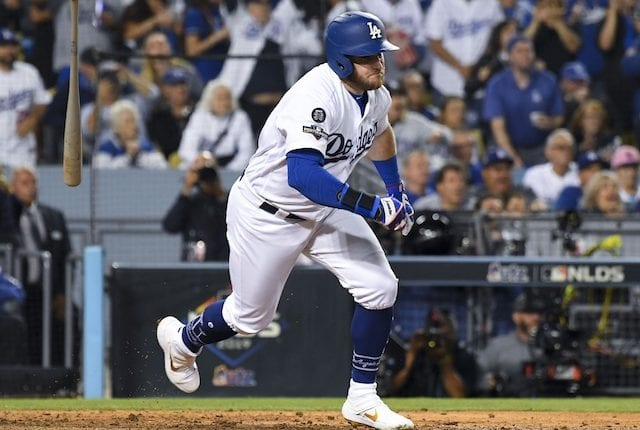Los Angeles Dodgers infielder Max Muncy hits a two-run single against the Washington Nationals in Game 1 of the 2019 NLDS
