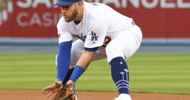 Los Angeles Dodgers infielder Max Muncy fields a ground ball during Game 1 of the 2019 NLDS
