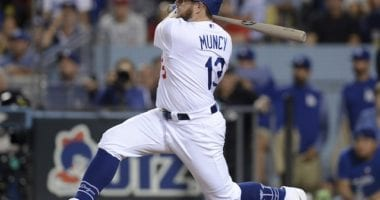 Los Angeles Dodgers infielder Max Muncy hits a single during Game 1 of the 2019 NLDS