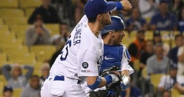 Los Angeles Dodgers All-Star Cody Bellinger throws out San Francisco Giants catcher Stephen Vogt