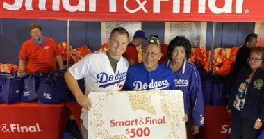 Los Angeles Dodgers outfielder presents a Smart & Final gift card during a Thanksgiving giveaway