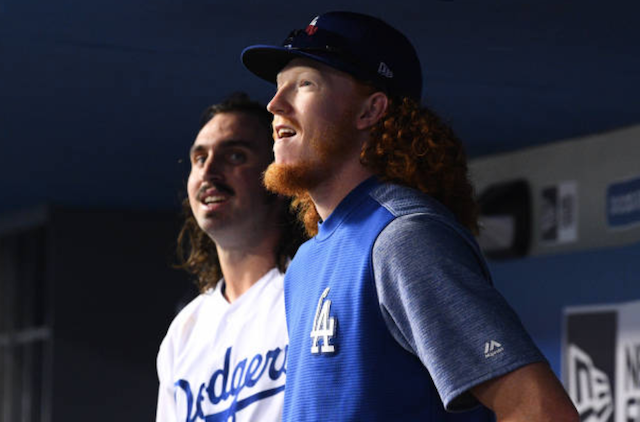 Los Angeles Dodgers pitcher Tony Gonsolin and Dustin May in the dugout at Dodger Stadium