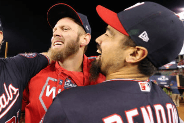 Washington Nationals teammates Anthony Rendon and Stephen Strasburg celebrate after winning the 2019 NLCS