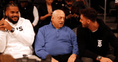 Former Los Angeles Dodgers manager Tommy Lasorda with Cody Bellinger and Kenley Jansen at a Los Angeles Lakers game