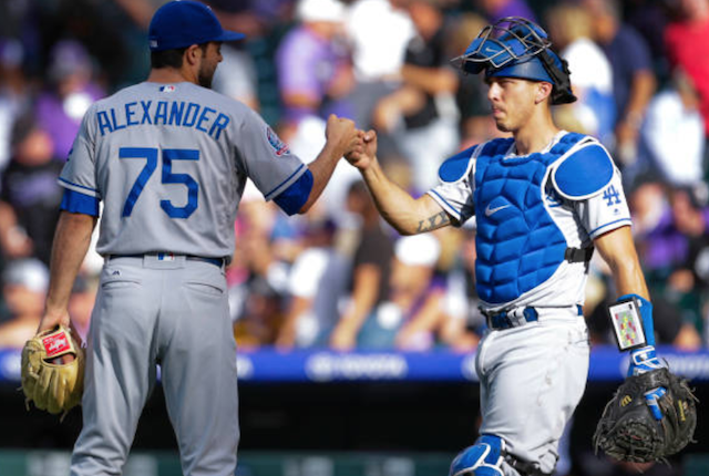 Los Angeles Dodgers teammates Scott Alexander and Austin Barnes celebrate after a win against the Colorado Rockies