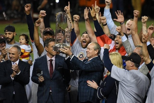 MLB commissioner Rob Manfred presents the 2017 World Series trophy to owner Jim Crane, manager AJ Hinch and the Houston Astros at Dodger Stadium