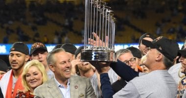 Former Houston Astros manager AJ Hinch hoists the 2017 World Series trophy