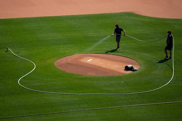 Pitcher's mound, ground crews watering