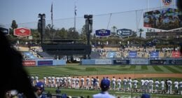 Dodgers lined up, national anthem, World Series banner